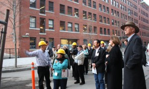Building Technology Showcase Project Manager Alex Cheimets directing tour attendees.