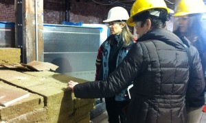 Members of the NESEA inspect insulation material being prepped for installation at the Building Technology Showcase.