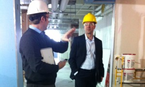 Price HVAC's Greg Loeppky and Julian Rimmer view the almost-completed building interior.