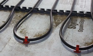 Closeup view of the tubing used in the radiant flooring system.